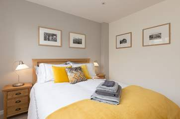 This is one of the two wonderful double bedrooms on the ground floor. A tranquil and understated stylish room to enjoy.