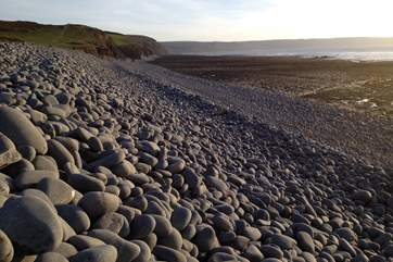 The long pebble ridge along the top edge of the beach is a wonderful natural landmark.