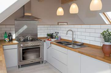 There is a fabulous kitchen with a range cooker and all the equipment you could possibly need.