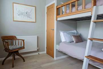 This view of the third bedroom gives you a good idea of how much space there is. The fitted wardrobe offers extra space for the other bedrooms too.
