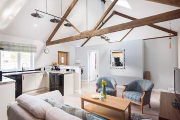 The open plan living-room, with the double bedroom en suite at one end and the twin room at the other.