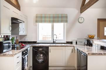 The kitchen is a social space where the cook can chat whilst preparing breakfast, lunch or dinner.