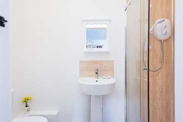 The en suite shower-room has a large double cubicle.