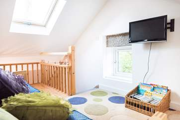 A flight of stairs lead up to the snug where there is a TV, books and lots of games for the younger ones.