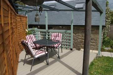 There is a raised deck in the garden, this can be accessed on the level through the garden gate or up a small flight of steps from the cottage.