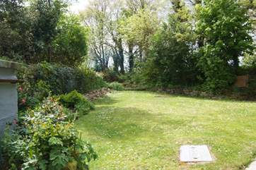 The garden is a good size and mainly enclosed.