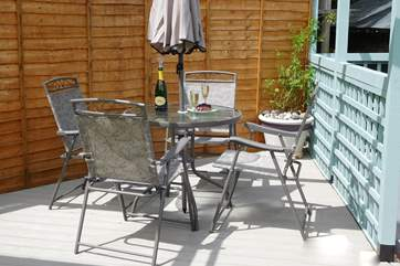 A sunny spot for a drink or dining al fresco on a warm evening.