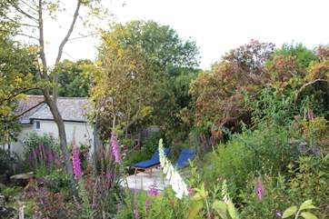 The pretty garden is behind the cottage and private for your use.