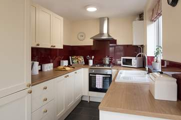 A bright and well-equipped galley kitchen which leads into the open plan living area.