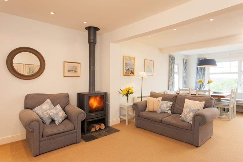 The cosy living-room has ample seating for everyone to relax together.