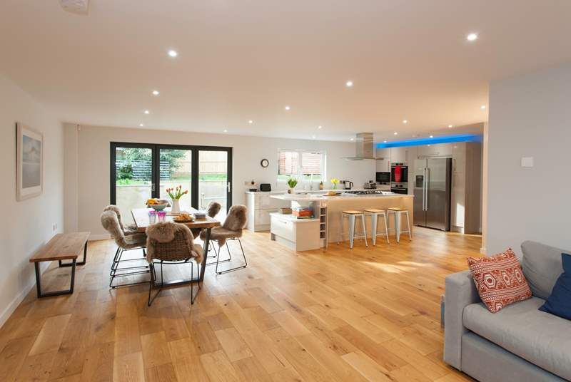 The open plan living/dining and kitchen-area is great for entertaining.