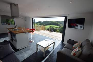 the open plan living space is contemporary and with all that fresh air, a wonderful place to be. There is underfloor heating in this area.