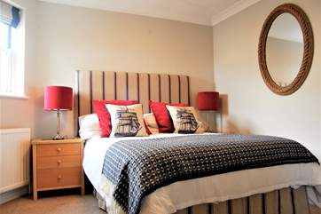 Bedroom 1 is beautifully styled.