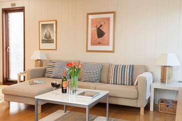 The beautiful open plan living space is a lovely and cosy space to come back and relax in