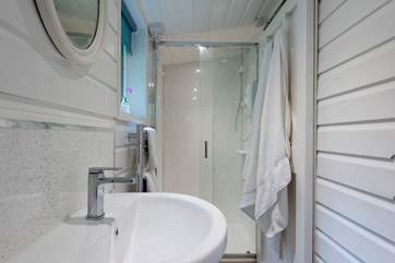 The en suite shower-room has a large shower cubicle, heated towel rail, wash-basin and WC.