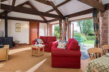The large open plan living area has two sets of French windows opening out to the patio and garden.