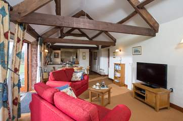 High ceilings and beams give this lovely barn conversion plenty of character.