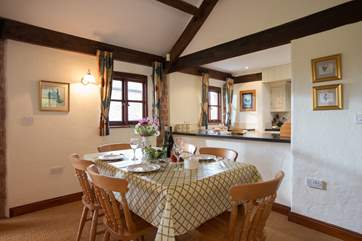 The dining-area and kitchen-area are at one end of this very spacious room.