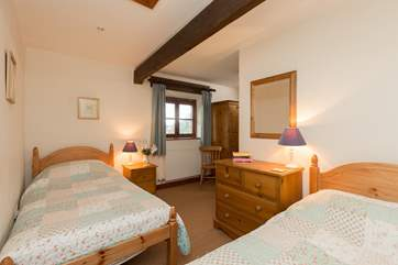 The twin bedroom is at the opposite end of the cottage.