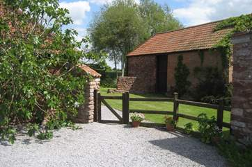 This is where you can park. The cottage is behind the fig tree to the left and the old stone barn to the right is a characterful reminder of times past ( not used when you are in the cottage )