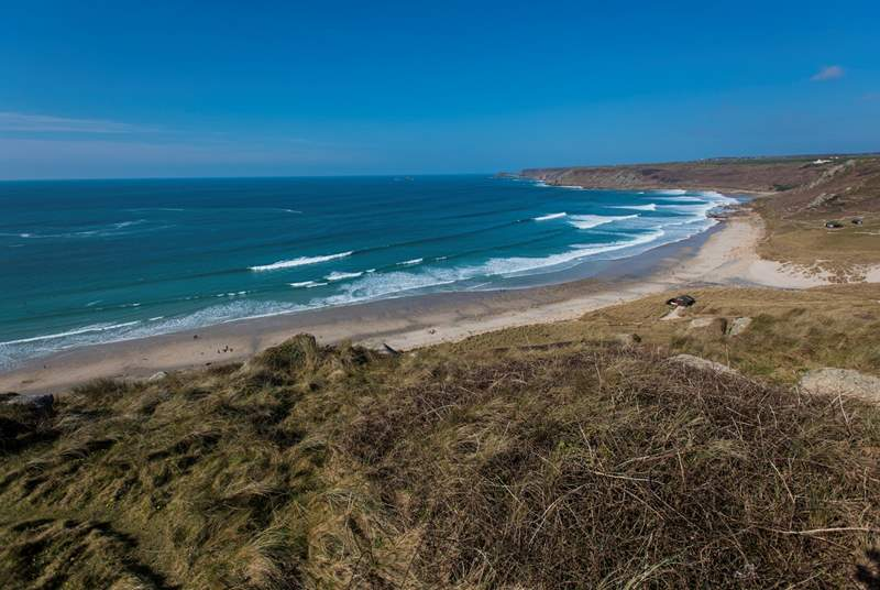 No Place is set above the white sand and blue seas at Sennen Cove (not the view from the property).