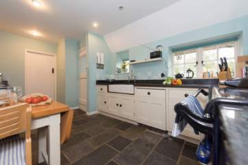 The kitchen is fitted with bespoke units.