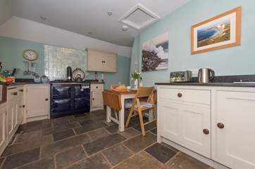 The kitchen/diner has an oil fired range cooker (there is also an electric 2 ring hob).