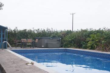 The outdoor heated swimming pool (the hot tub at the far end of the picture is not available).