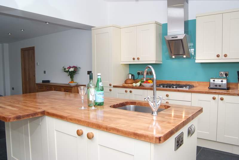 The ground floor has a spacious open plan layout with a huge kitchen island as a focal point.