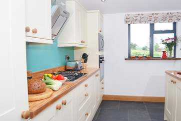 The well designed kitchen means plenty of room for cooking sociable holiday meals.