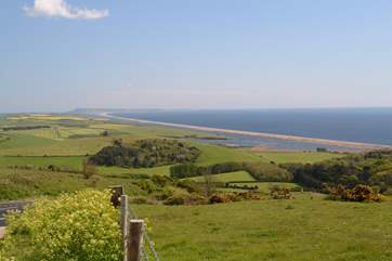 This spectacular view is of Chesil Beach, with Portland in the background taken from the Jurassic Coast road between Weymouth and Bridport; fabulous views in both directions.
