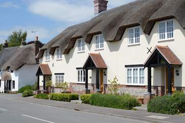 Tolpuddle is the middle cottage in the photo, the parking is behind the cottages, turn right before the white thatched cottage.