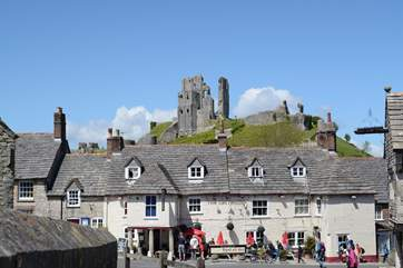 Corfe Castle stands imposingly above the village of Corfe. The Swanage steam railway runs along the side of the village and stops at the little station there.