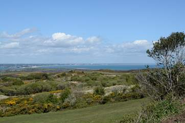 Taken from the Corfe to Studland Road, from this viewpoint you can see Poole's natural harbour in one direction, and in the other Bournemouth bay across to the Isle of Wight.