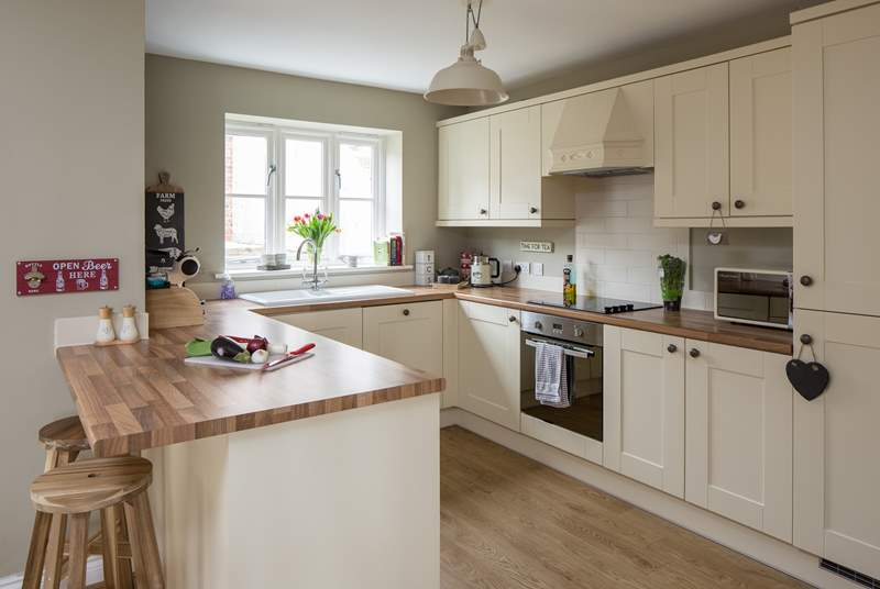 The open plan kitchen is very well-equipped and has plenty of space to create some delicious holiday treats.