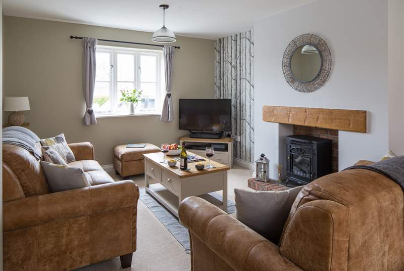 The sitting-area has books, games and a wood-burner effect electric stove for cosy winter evenings.