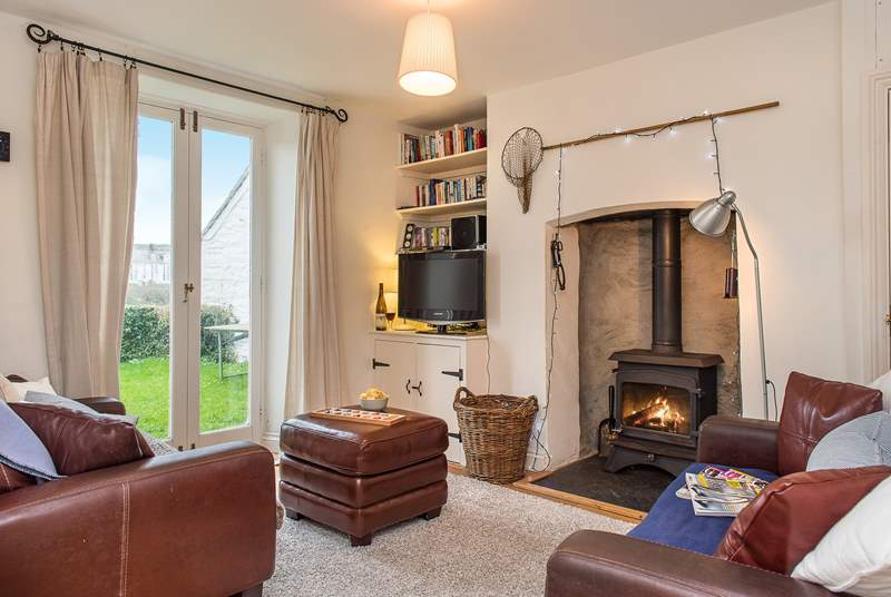 The cosy sitting-room with its toasty wood-burner makes this an ideal reatreat whatever the weather.