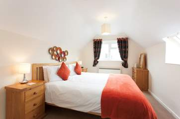 The master bedroom has a lovely king size bed and en suite bathroom, encouraging that great night's sleep