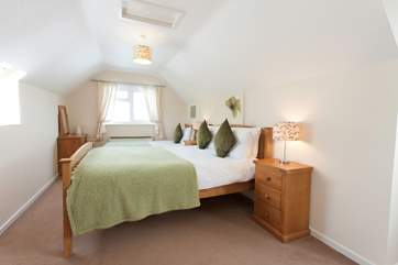 The second bedroom on the first floor is home to a  double bed and a single bed