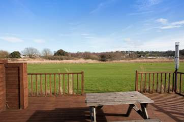 The decking out to the back looks across to the Seaview Nature Reserve