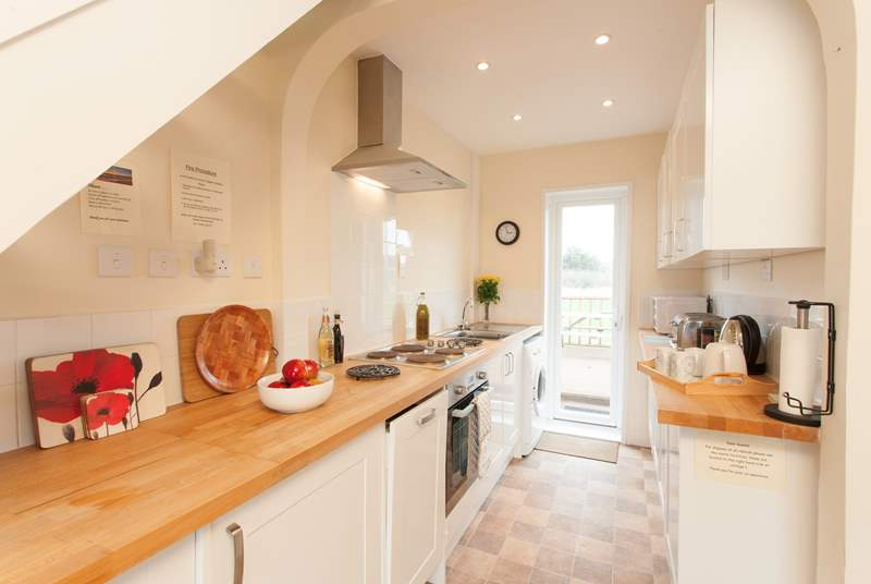 The cottage has a lovely galley kitchen, a pretty area to cook up a feast