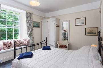 Pretty bedroom two has a double bed, and estuary views.
