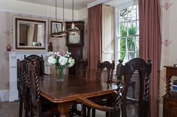 The more formal dining area overlooks the rear garden, and estuary.