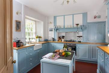 The soft blue cupboards compliment the kitchen beautifully.