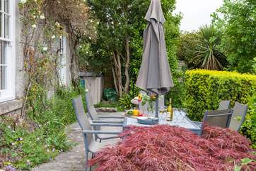 The rear terrace, is the perfect place for dining.