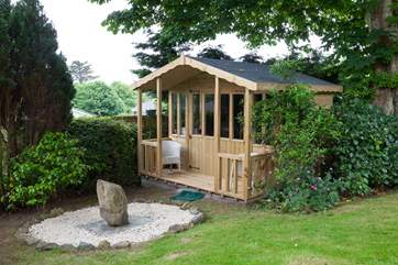 The summerhouse is located at the bottom of the rear garden, and is a gorgeous spot to read a book.