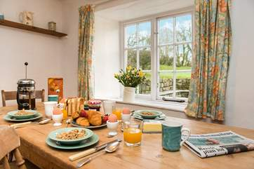 The kitchen/dining-room enjoys views over the garden.