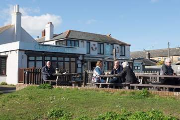 The local pub is popular for its good food and local ales