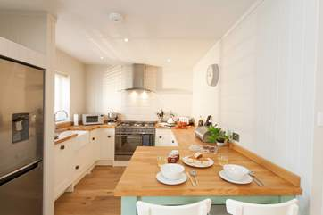The beautiful kitchen looks out to the decked garden