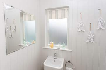 The en suite is lightly decorated